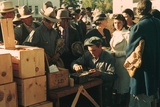 People Line Up to Receive Surplus Foods in St. Johns Arizona. Oct, 1940 Photo