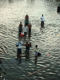 African Americans Walk Through New Orleans Flood Waters to Evacuation Centers, 2005 Photographic Print