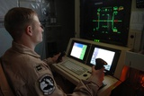 Air Force Officer Maneuvers a Predator Reconnaissance Drone over Iraq, 2005 Photographic Print