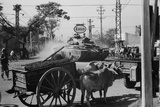 A US Army Tank Shares the Streets of Saigon, Vietnam, with Ox Carts in 1969 Posters