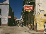 Street in San Juan Puerto Rico Where Many Business Advertise with Coca Cola Signs. Dec, 1941 Posters