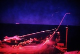 Night Flight Operations on USS Saratoga During First Gulf War, Feb. 1, 1991 Photo