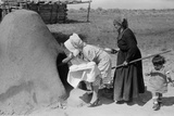 Spanish-American Women Placing Bread in Earthen Oven, New Mexico, 1930s Photo
