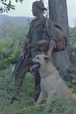 Camouflaged US Marine and His Scout Dog Named 'Major' in Vietnam, Nov. 1967 Posters