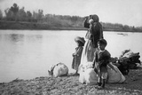 Mexican Women with Children and Bundles Looks over the Rio Grande River, 1910 Photo