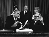 Lyndon Johnson Signing the Medicare Bill with Former President Truman, July 7,1965 Print