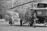 President Jimmy Carter Carrying His Own Luggage a to the Presidential Helicopter, 1978 Posters