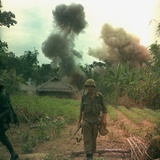 US Marines Walk Away from Blown Up Viet Cong Base, May 1966 Photo