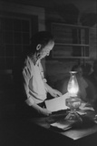 Man Reading by the Light of a Kerosene Lantern in Pie Town, Mexico, 1939 Posters