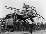 Large-Scale Spraying Insecticide Containing Ddt on a Farm in Illinois in 1948 Prints