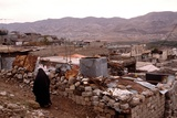Kurdish Woman of Airoshky Walks in Her Destroyed Town in Nov. 18, 1991 Print