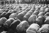 Iranians Kneeling in Prayer at an Demonstration During Iran Hostage Crisis, 1979 Prints