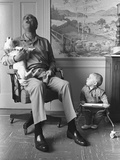 President Lyndon Johnson Sings with Dog Yuki While His Grandson Looks On, 1968 Photo