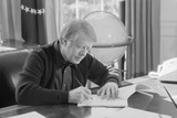 President Jimmy Carter Working at His Desk in the White House Oval Office, 1970s Photo