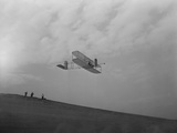 Wilbur Wright Pilots a Glider During at Kitty Hawk, North Carolina, Ca. 1902 Poster
