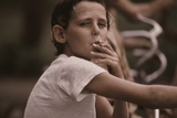 A Pre-Teen Boy Smoking a Cigarette on Kansas City's West Side, Ca. 1973-75 Photo