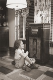 Little Girl Smiles as She Enjoys a Radio Program in the 1930s Posters