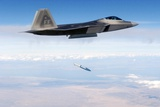 F-22 Raptor Releases a 1,000-Pound over the Utah Test Range, Oct. 2005 Photographic Print
