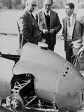 Italian Enzo Ferrari (Left), Looks over a 1959 Racing Car with Technicians Prints