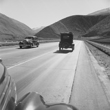Migrants' Old Car Travels on the Three Lane Highway in California, 1939 Photo