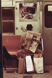 NYC Subway Passenger Reading Newspaper with Shopping Bags in May 1973 Photographie