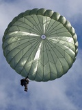 Soldier of the 82nd Airborne Descends from a Parachute Drop Over, 2010 - Photo