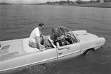 President Lyndon Johnson Taking Guests for a Cruise in His Amphicar, April 11, 1965 Photo