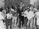 Attorney General Robert Kennedy Surrounded by African American Children, Aug. 1963 Photo