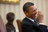 President Barack Obama Laughs During a Meeting in the Oval Office, Jan. 24, 2011 Prints