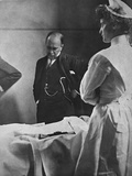 Sir William Osler Reading a Patient's Chart at Bedside as a Nurse Watches, Ca. 1903 Photo