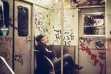A Lone Passenger Amidst a Graffiti Painted Subway Car Interior, May 1973 Photographie