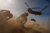 Soldiers in the Dust of a Chinook Helicopter Hauling a Humvee, April 2011 Photo
