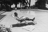 Richard Nixon Reading Newspapers While Sitting by the Pool in San Clemente, Ca. 1969-74 Photo