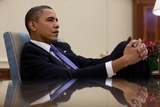 President Barack Obama Leans Back During a Meeting in the Oval Office, Feb. 22, 2010 Prints