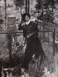 Calamity Jane at the Grave of Buffalo Bill in 1900 Photo