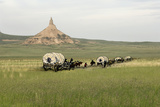 Covered Wagons Passing Chimney Rock, a Landmark on the Oregon Trail, Nebraska Photographic Print