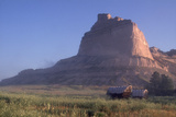 Covered Wagons on the Oregon Trail at Scotts Bluff, Nebraska, at Sunrise Fotodruck