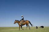 A Cowboy Rides His Horse On a Ranch Near Fort Pierre Photographic Print by Joel Sartore