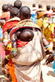 A Samburu Baby Rests On His Mother As She Dances with Others Photographic Print by Robin Moore