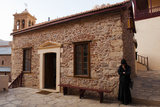 A Nun Waits By a Small Meeting Building Within Saint Catherine's Monastery Photographic Print by Matt Moyer
