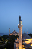 A Minor Minaret, Foreground, Competes with the Blue Mosque Dominating the Skyline Photographic Print by Dave Yoder
