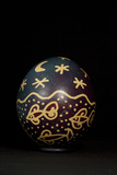 An Easter Egg Decorated with Fish Swimming Under a Stary Sky Photographic Print by Joe Petersburger