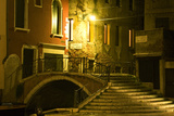 A Stairway and Bridge Over a Canal At Night Photographic Print by Joe Petersburger