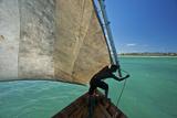 A Fisherman Sails His Dhow Off the Coast of Matemo Island, Mozambique Fotografisk tryk af Jad Davenport