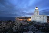 Lighthouse At Capo Testa, Near Santa Teresa Di Gallura, On Sardinia's Northernmost Headland Photographic Print by David Yoder