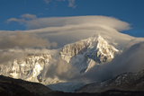 The Summit of Cerro San Lorenzo Emerges From Clouds After Dawn Photographic Print by Beth Wald