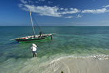 Fishermen Load a Dhow Off Matemo Island in Mozambique Photographic Print by Jad Davenport