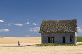 A Person Running From an Abandoned Farmhouse Photographic Print by Rich Reid