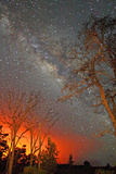 The Milky Way Shines As the Glow of Lava Light Reflects in the Sky Photographic Print by Steve And Donna O'Meara