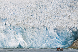 Ecotourists in a Zodiac in Front of Dawes Glacier Photographic Print by Rich Reid